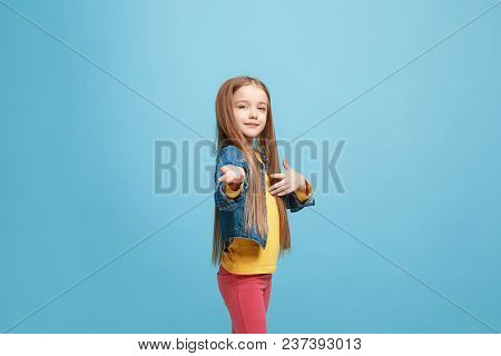 Happy Teen Girl Standing, Smiling Isolated On Trendy Pink Studio Background. Beautiful Female Half-l