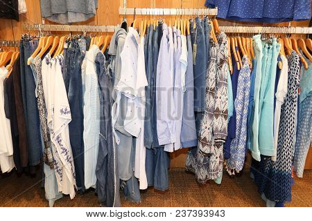 Cloth On Clothes Rail In Clothing Store Colorful Women Dresses On Hangers In A Retail Shop