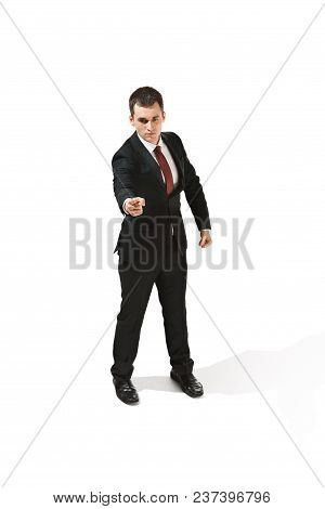 Above Front Portrait Of Businessman With Serious Face. Confident Professional Pointing At Camera. Di
