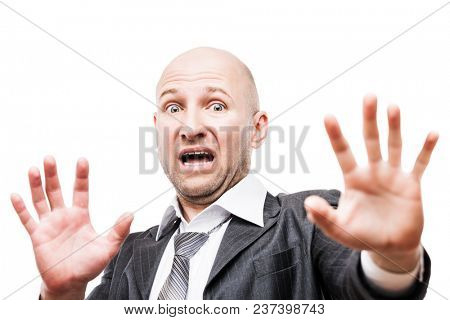 Scared or terrified businessman with fear and stress expression hand gesturing hide face stop sign white isolated