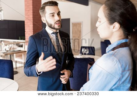 Confident Successful Male Restaurateur With Beard Working With Staff: He Gesturing While Explaining