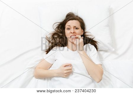 Top View Of Tired Stressed Crying Young Woman Lying In Bed With White Sheet, Pillow, Blanket. Pensiv
