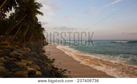 Seashore Landscape. Sri Lanka During Sea Storm Under Heavy Clouds As Seen From The Beach. Sri Lankan