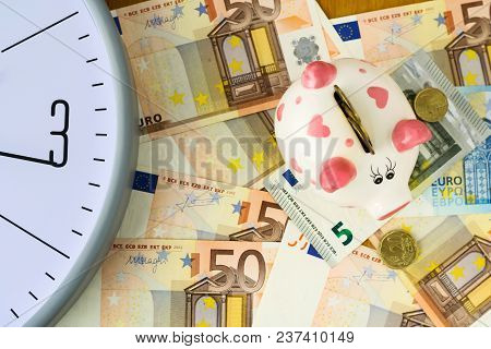 Clock, Euro Banknotes And Piggy Bank. Concept Time Is Money. View From Above. Business, Finance. Bac