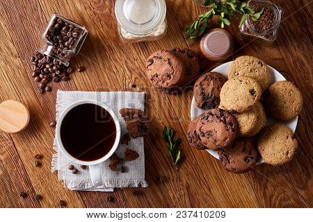 Conceptual Composition With Overturned Glass Jar Of Coffee Beans, Transparent Bottle Of Instant Coff