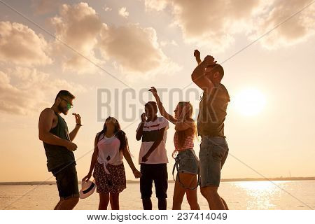 Positive Euphoric Young Multiethnic Friends In Comfortable Casual Clothing Dancing Together At Sea,