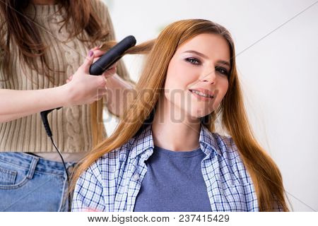 Woman getting her hair done in the beauty salon