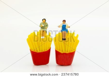 Miniature People : Woman Sitting On Junkfood. Image Use For Healthcare And Diet Concept.