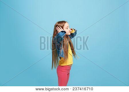 Argue, Arguing Concept. Profile Of Beautiful Female Half-length Portrait Isolated On Blue Studio Bac