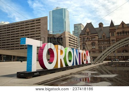 TORONTO CANADA APRIL 13, 2017: Colourful Toronto sign at Nathan Phillips square in Toronto, Canada.  The Square is used regularly for art exhibits, concerts, rallies and other ceremonies.