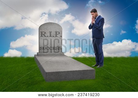 Businessman mourning the death of success