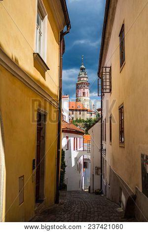 Narrow Street In Cesky Krumlov And View Of Castle Tower, Czech Republic