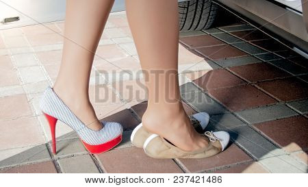 Closeup Photo Of Sexy Woman Changing Shoes Before Driving A Car