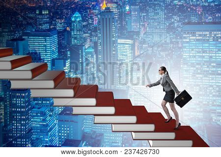 Businesswoman student climbing the ladder of education books