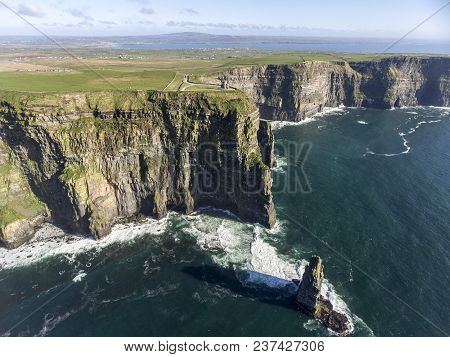 Beautiful Scenic Aerial Drone View Of Ireland Cliffs Of Moher In County Clare. Sunset Over The Cliff