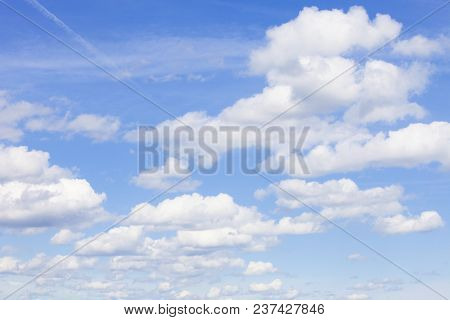 Blue Sky with White Beautiful Cumulus Clouds. poster