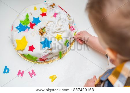 Little Baby Touches His Birthday Cake Which Lies On The Table