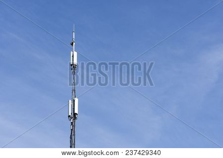 Telephone Antenna On Blue Sky Background Signal
