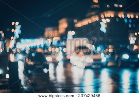 Bokeh. Blurred City At Night. Beautiful Abstract Background With Defocused Buildings, Cars, City Lig