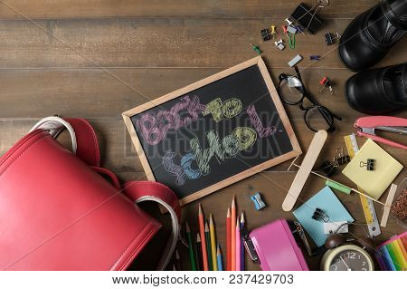 Back To School Text On Black Chalk Board With Bag