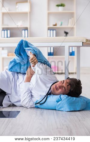 Doctor sleeping on floor after long night shift