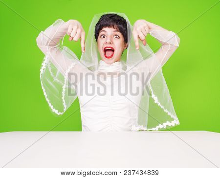 Excited Bride In Wedding Attire Pointing With Her Fingers. Portrait Of A Girl Pointing Thumbs Down.