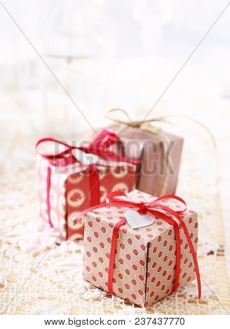 Little Christmas Gift Boxes On A White Table