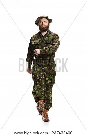 Young Army Soldier Wearing Camouflage Uniform Going Isolated On White Studio Background In Full-leng