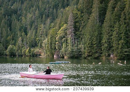 Bucharest, Romania - September 9, 2017: Couple Boating On Lacu Rosu Or Red Lake In Eastern Carpathia