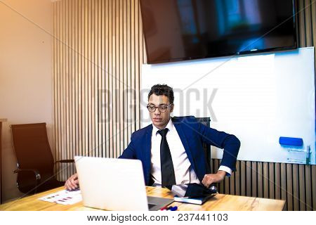 Man Intelligent Business Person Having Online Video Call Via Laptop Computer, Sitting In Office Inte