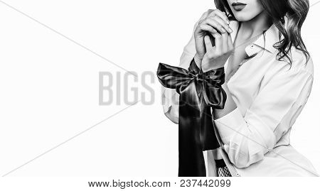 Beautiful Female Hands Tied With Black Ribbon. Isolated In White. Sexy Game. Fetish And Sex. Erotic