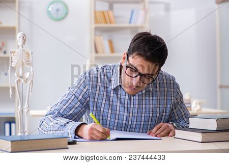 Medical student studying in classroom