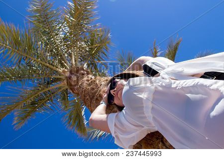 Luxurious Landscape With A Beautiful Caucasian Young Woman Near The Palm Tree At Resort In Egypt, Fo