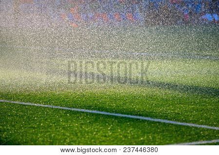 Irrigation Turf. Sprinkler Watering Football Field. Soccer Stadium