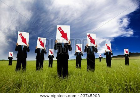 group of businessman in black suit and holding red arrow down graph