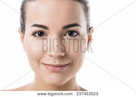 Headshot Of Beautiful Girl With Clean Skin Looking At Camera Isolated On White