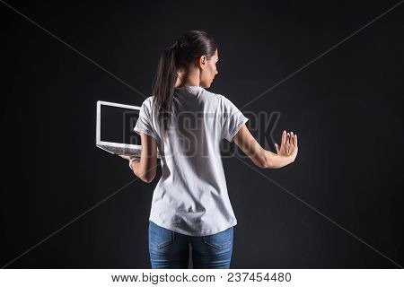 Contemporary Technology. Smart Pleasant Young Woman Holding A Laptop And Looking At The Digital Scre