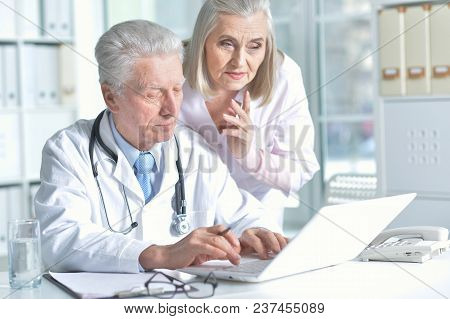 Portrait Of Male And Female Doctors Working