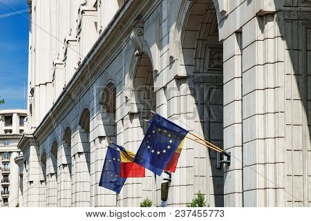 European Union And Romania Flags On The Wall Of The Building Of Ministry Of Regional Development And