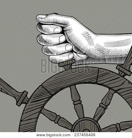Hands of man holding a steering wheel. Vintage engraving stylized drawing
