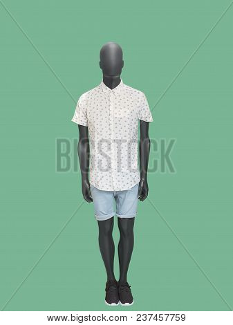 Full-length Man Mannequin Dressed In Short Sleeve Shirt And Blue Shorts, Isolated. No Brand Names Or