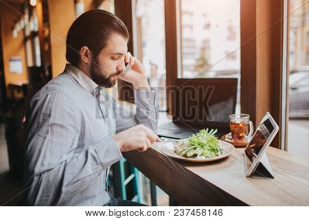 Busy Man Is In A Hurry, He Does Not Have Time, He Is Going To Eat Snack On The Go. Worker Eating, Dr