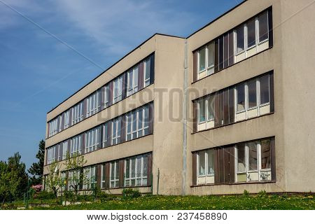 Typical architecture of school buildings built in communist era in Czech Republic in original condition before reconstruction poster