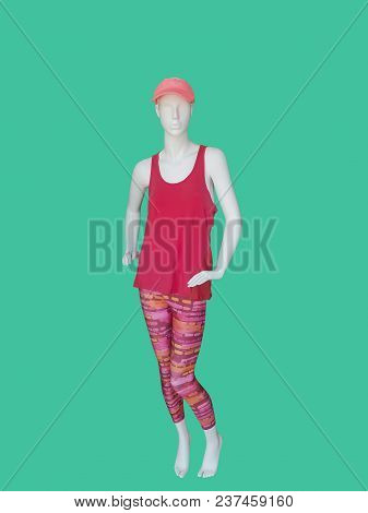Full-length Female Mannequin Dressed In Sportswear, Isolated On Green Background.  No Brand Names Or