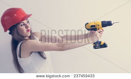 Young Funny Stressed Woman Using Power Driil. Girl Working At Flat Remodeling. Building, Repair And