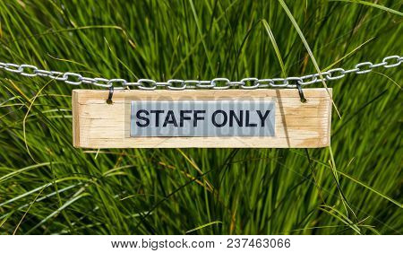 Staff Only Sing Hanging  On A Chian.
