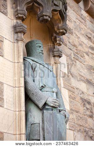 EDINBURGH, UK - AUG 9, 2012: William Wallace statue at the Gatehouse entrance to the Edinburgh Castle