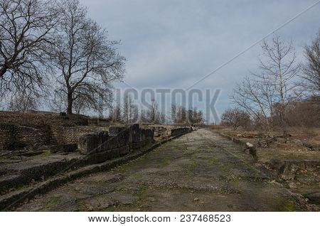 Ruins And Old Road At The Archaeological Park Of Dion. Pieria, Macedonia, Greece