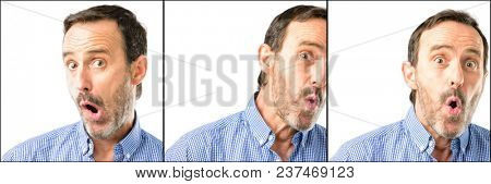 Middle age handsome man closeup happy and surprised cheering expressing wow gesture