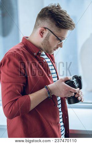 Bearded Man Using Camera By Light Window